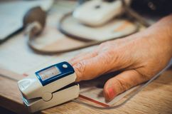 Pulse oximeter on the finger used for measuring pulse royalty free stock photography