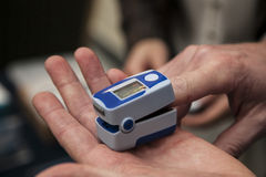 Pulse oximeter. For monitoring the level of oxygen and heartbeat stock photography