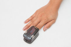 Pulse Oximeter. Patient with  on finger stock image
