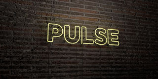 PULSE -Realistic Neon Sign on Brick Wall background - 3D rendered royalty free stock image. Can be used for online banner ads and direct mailers Stock Photography