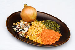 Pulse Soup Ingredients. Ingredients for Pulse Soup on brown plate on white table-cloth Royalty Free Stock Images
