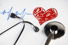 Pulse trace with red heart and medical stethoscope. Cardiogram pulse trace with red heart and medical stethoscope concept for cardiovascular medical exam on a Stock Image