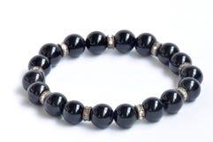 Pulsera de perlas negras Foto de archivo