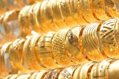 Pulseras de oro Foto de archivo libre de regalías