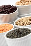 Pulses. Bowls with different kinds of lentil, beans and chickpea royalty free stock photos