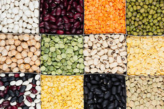 Pulses food background, assortment - legume, kidney beans, peas, lentils in square cells closeup top view. Healthy protein food royalty free stock photos