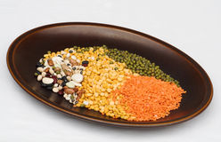 Pulses and legumes. Dish of pulses and legumes on a pale table cloth Royalty Free Stock Photography