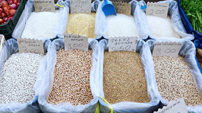 Pulses and Rice at Greek Market. Crates of rice, chickpeas, lima beans, lentils and black eye peas for sale in bulk at a Greek outdoor farmers market, or laiki Stock Images