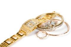 Pulso de disparo e jóia dourados Fotografia de Stock Royalty Free