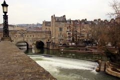 Pulteney Bridge and Avon River Weir. Pulteney Bridge over the Avon river and weir in Bath, England Royalty Free Stock Image