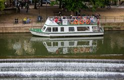 Pulteney Weir, Bath, with the river cruise boat Sir William Pulteney docked boarding passengers taken in Bath, Somerset, UK royalty free stock photography