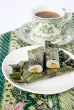 Pulut Panggang - Malay cakes and tea Royalty Free Stock Photos