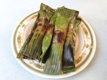 "Pulut panggang is a Malay or Nonya cuisine literally translated as ""grilled glutinous rice"". It is a char grilled rice parcels with a spiced filling of Royalty Free Stock Image"