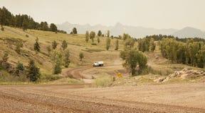 Pulverização da estrada de terra Fotografia de Stock