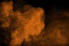 Pulvermoln mot mörk bakgrund Royaltyfria Bilder