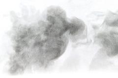 Pulvermoln mot vit bakgrund Arkivfoto