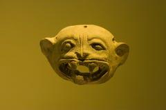 Puma head. Macro of a ceramic puma mask from inca archaeological find Stock Photos
