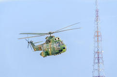 Puma IAR helicopter pilots training in the blue sky. Telecommunications antenna Royalty Free Stock Images
