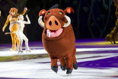 Pumbaa on Ice. GREEN BAY, WI - MARCH 10:  Pumbaa from The Lion King on skates at the Disney on Ice Treasure Trove show at the Resch Center on March 10, 2012 in Royalty Free Stock Photo