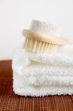 Pumice brush and towel Stock Photo