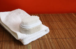 Pumice brush and towel at spa Royalty Free Stock Photography
