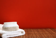 Pumice brush and towel at a spa - copy space Royalty Free Stock Photography
