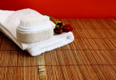Pumice brush and towel at a spa - copy space Royalty Free Stock Photos