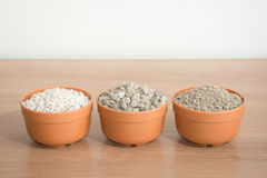 Pumice pebbles in pots Royalty Free Stock Photography