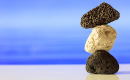 Pumice rocks stack on blue sea background Royalty Free Stock Image