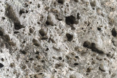 Pumice rough textured rock surface. Natural stone with freezes bubbles background Stock Photos