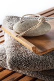 Pumice stone for natural foot care and cleansing, wooden background Royalty Free Stock Photography