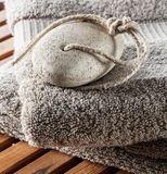 Pumice stone for purifying foot care and towel for hygiene Stock Photography