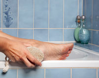 Pumice stone removing callus Royalty Free Stock Photography