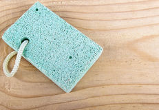 Pumice stone scrub tool on wooden board Spa concept Royalty Free Stock Images