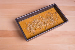 Pumkin bread batter in a pan Stock Images