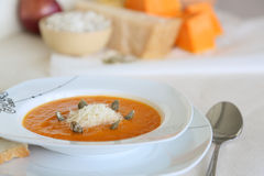 Pumkin cream soup with its ingridients in the background Stock Image