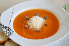Pumkin cream soup with parmesan cheese Royalty Free Stock Photos