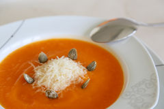 Pumkin cream soup with parmesan cheese Royalty Free Stock Photo