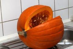 Pumkin. / Cut pumpkin lying in the snow royalty free stock photo