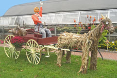 Pumkin Head Rides a Wagon Stock Photography