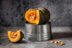 Pumkin over Grey Background. Sliced Bright Orange Pumkin over Grey Background, copy space for your text Stock Photo