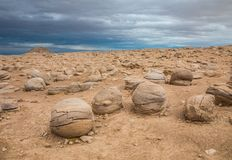 Pumkin Patch. Pumkin Sized Sandstone Concretions Eroded From Desert Floor With Stormy Sky At Ocotillo Wells State Vehicular Recreation Area, California stock image