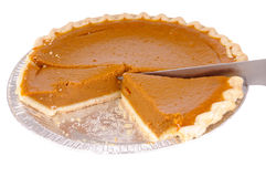 Pumkin pie. In a dish isolated on white royalty free stock photos