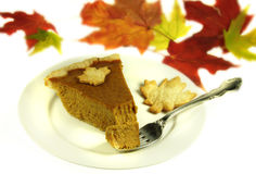Pumkin Pie with Fall Leaves Stock Photo
