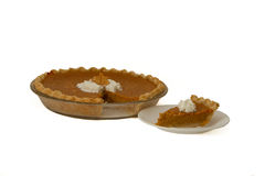 Pumkin Pie and slice. Fresh baked home made pumpkin pie and slice Stock Photo