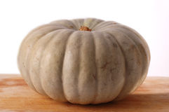 Pumkin on a wooden board Stock Photography