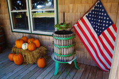 Pumkins and american flag. Not long before halloween, pumkin and an american flag in a rural setting Royalty Free Stock Image