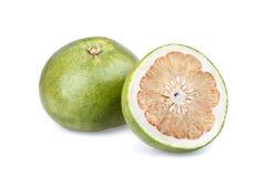 Pummelo (citrusa grandis) - halvt snitt Arkivbild