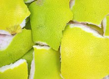 Pummelo fruit rind. The green and yellow peelings of a pummelo fruit Royalty Free Stock Images