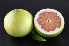 Pummelo. Organic pummelo on black background Royalty Free Stock Photography